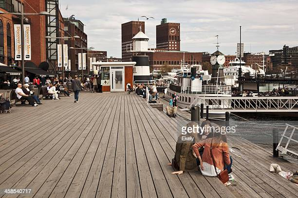 young women at the jetty. - traditionally norwegian stock pictures, royalty-free photos & images