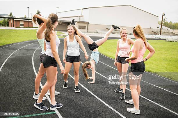 Young women athletes laughing on school track