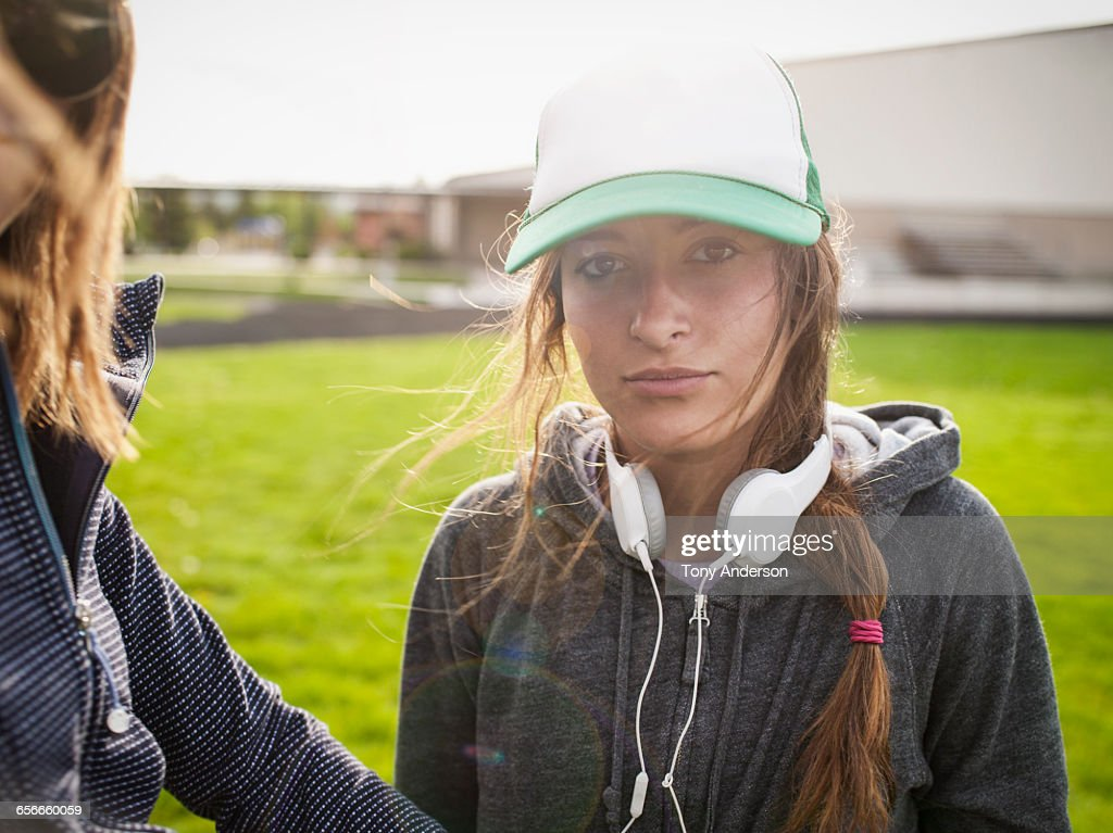 Young women athletes on school playing field : Stock Photo