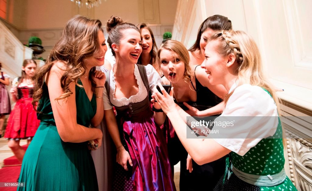 Young women attend a student's ball in Hofburg palace in Vienna, Austria, on February 2, 2018. Some 450 balls organised in the Austrian capital through the winter are expected to attract more than 500,000 revellers, mostly from Vienna, while about 55,000 of them are visitors from abroad. All the while, thousands will earn their living in the flourishing sector, in hotels, restaurants, fashioning evening wear, hairdressing, floristry as well as the all-important ballroom orchestras. STORY by Sophie MAKRIS
