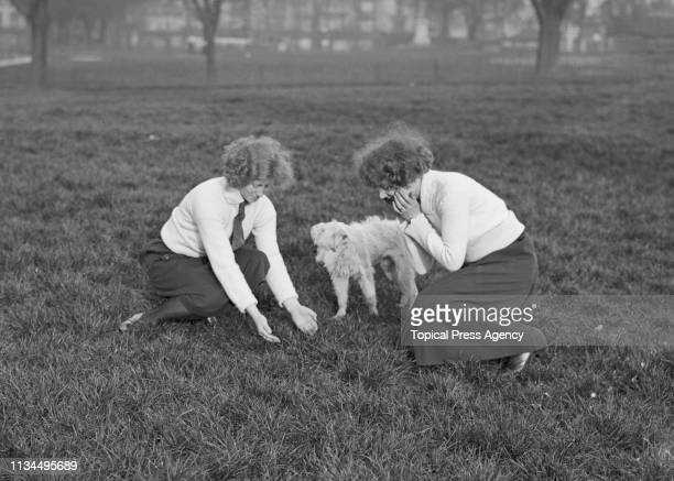 Young women bathing their faces in dew from the grass on Southampton Common on May Day morning in Southampton Hampshire 1st May 1922 According to...