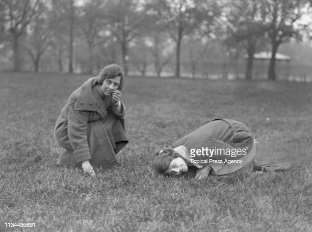 Young women bathing their faces in dew from the grass on Southampton Common on May Day morning in Southampton Hampshire 1st May 1923 According to...