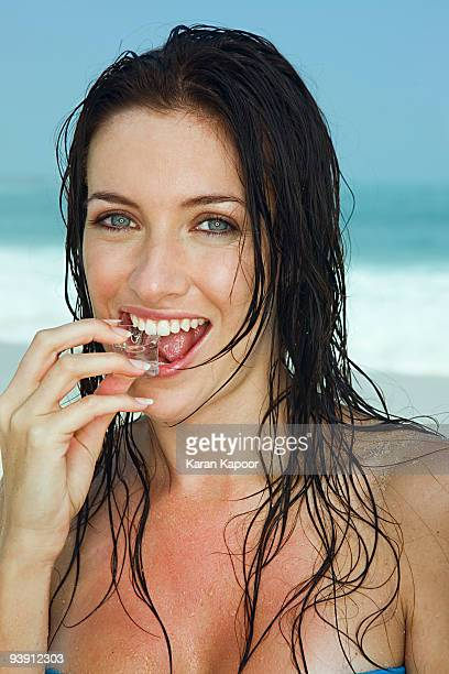 young women biting into ice cube - hot glamour models stock pictures, royalty-free photos & images