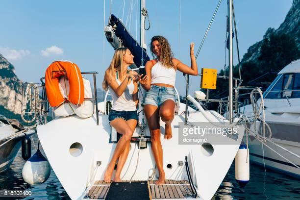 Young women boarding sailboat