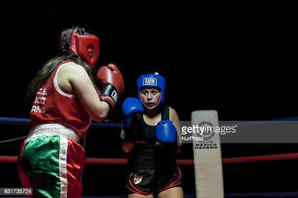 Young women boxers from Argentina and Chile fight in an exhibition combat Amateur boxing matches were held at Club Mexico between Argentine and...