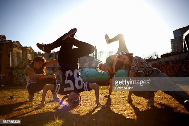 Young women breakdancing headstand freeze