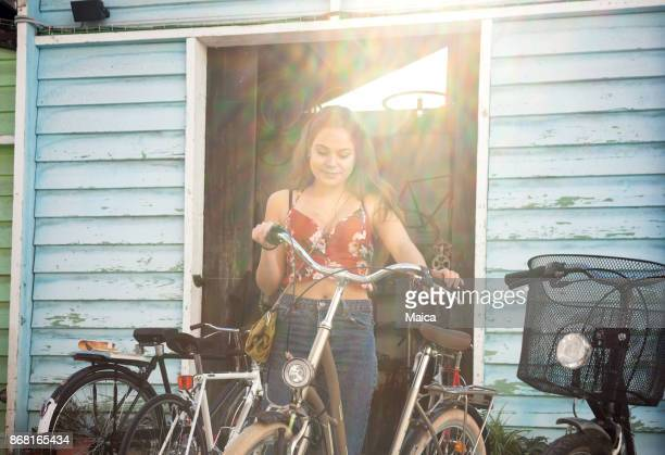 young women buying at the flea market - garage sale stock pictures, royalty-free photos & images