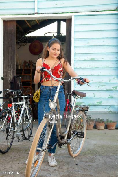 young women buying bicycle at the market - garage sale stock pictures, royalty-free photos & images