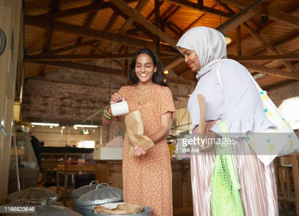 Young women buying food at plastic free market