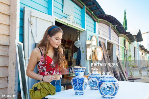 Young women buying porcelain at the market