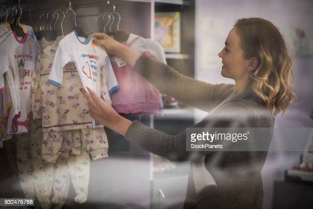 Young women bying kids clothes