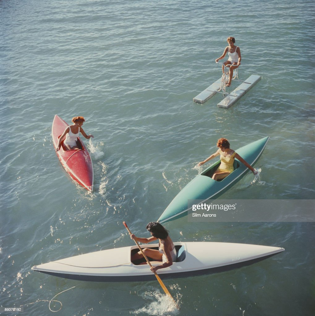 Young women canoeing on the Nevada side of Lake Tahoe, 1959.