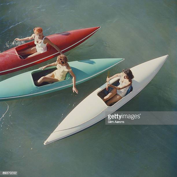 Young women canoeing at Zephyr Cove on the Nevada side of Lake Tahoe, USA, 1959.