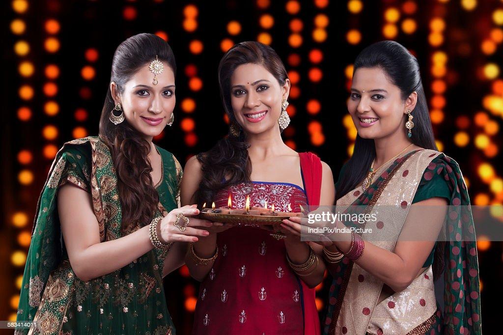 Young women celebrating Diwali : Stock Photo