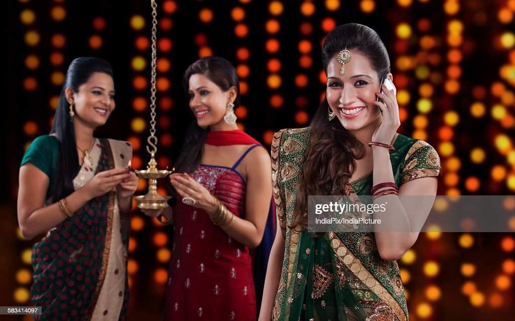 Young women celebrating Diwali : Stock Photo