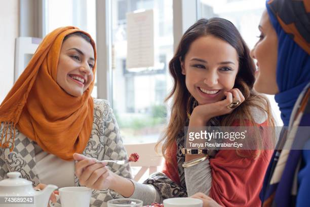 young women chatting at café.  - dessert stock pictures, royalty-free photos & images