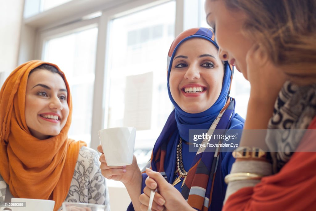 Young women chatting at café.  : Stock Photo