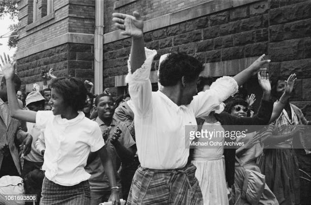Young women cheering outside the 16th Street Baptist Church headquarters of the Birmingham Campaign in Birmingham Alabama May 1963 The movement which...