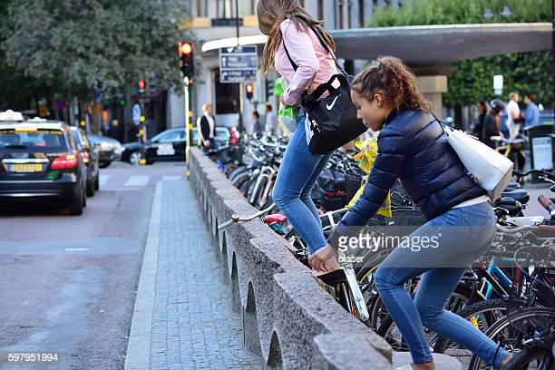 Young women crossing street the hard way