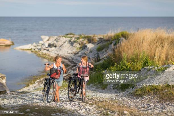 young women cycling on sea coast - gotland bildbanksfoton och bilder