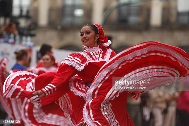 CONTENT] GUADALAJARA JALISCO MEXICO SEPTEMBER 01 Young women dance as the International Mariachi and Charreria celebrate their 20th anniversary in...
