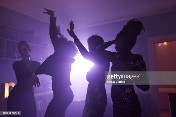 young women dancing and cheering at home party - party stock pictures, royalty-free photos & images