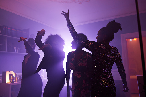 Young women dancing and cheering at home party - gettyimageskorea