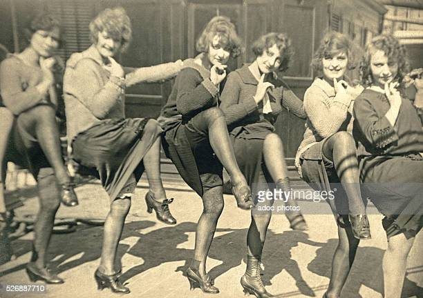 Young women dancing in a French street Ca 1900