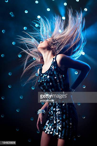 young women dancing on smoky disco background - grey dress stock pictures, royalty-free photos & images