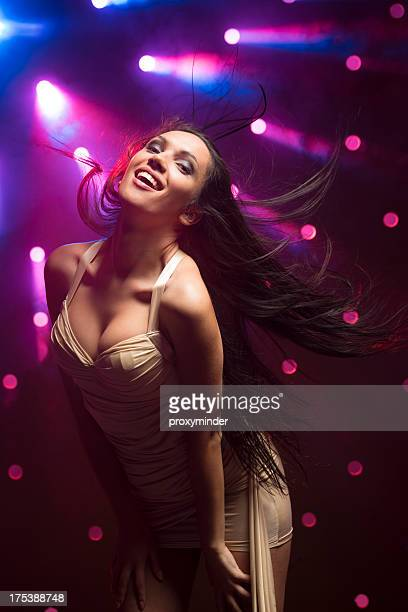 young women dancing on smoky disco background - hot latina women stock photos and pictures