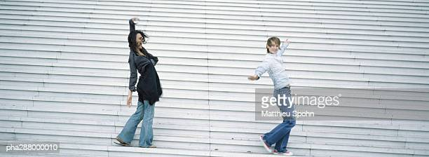 Young women dancing on steps