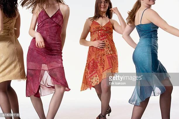 young women dancing - カクテルドレス ストックフォトと画像