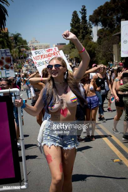 Young women demanding to go topless with the slogan 'Free the nipple' at the San Diego Pride Parade