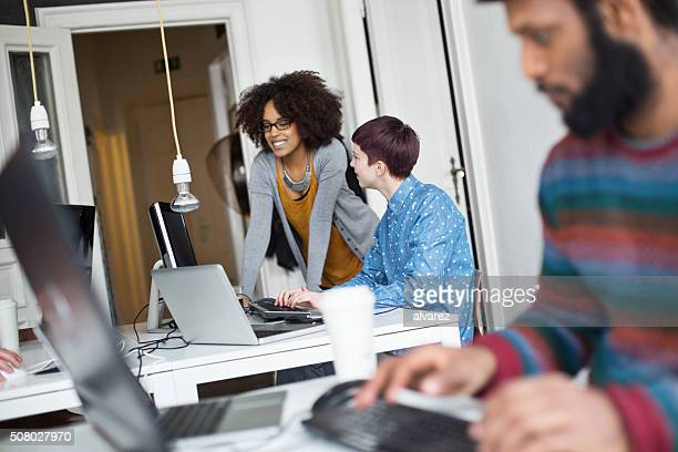young women discussing work in office - central europe stock photos and pictures