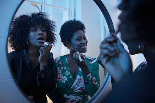 Young women doing make-up in the bathroom mirror at pre-party - gettyimageskorea
