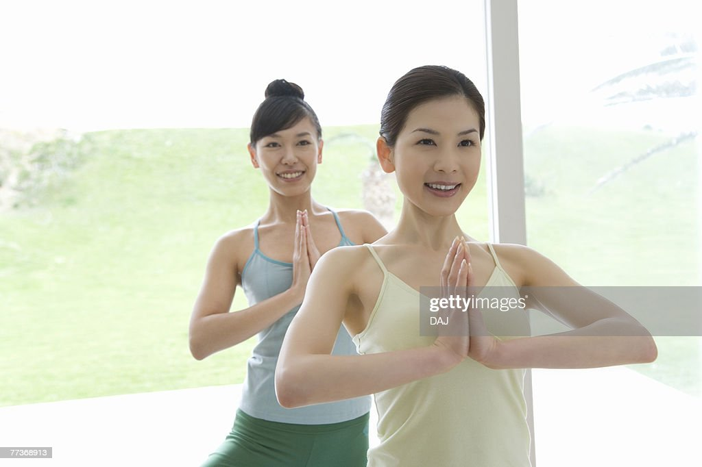 Young women doing yoga exercise, front view   : Photo