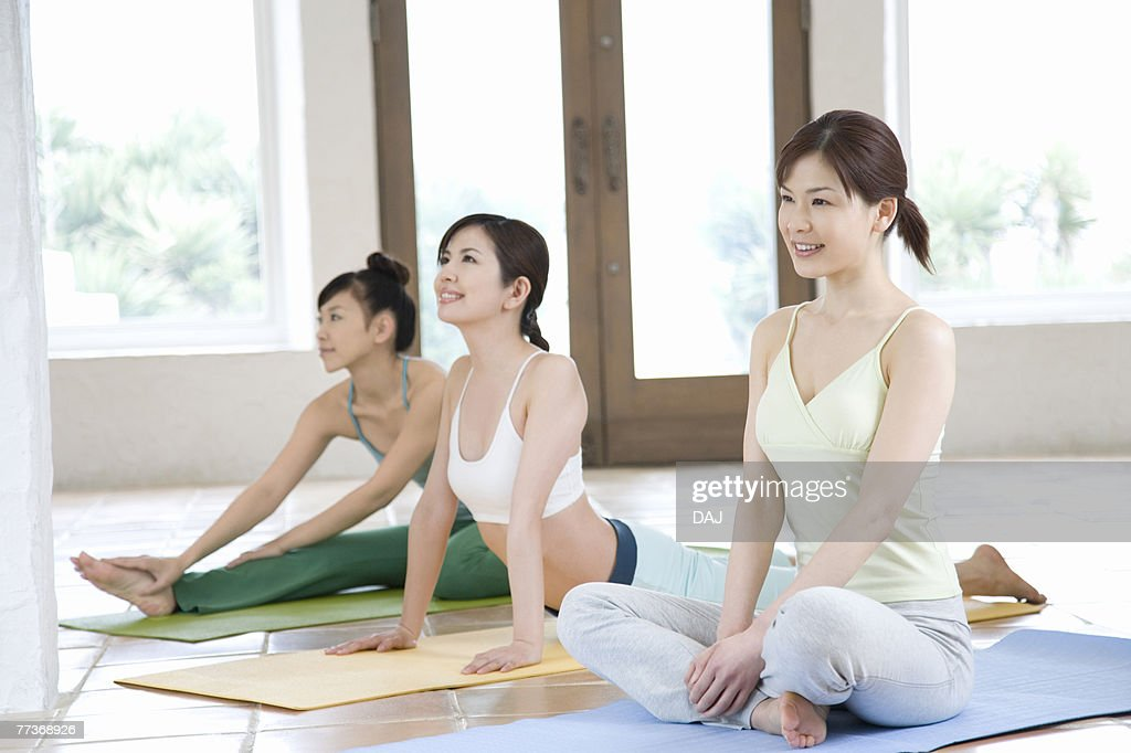 Young women doing yoga exercise, stretching, three types, side view   : Photo