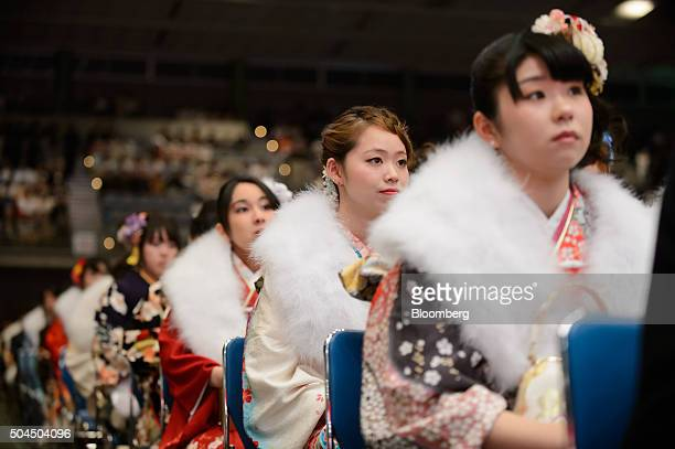 Young women dressed in furisodestyle kimonos attend a Coming of Age Day ceremony in Kawasaki City Kanagawa Prefecture Japan on Monday Jan 11 2016...