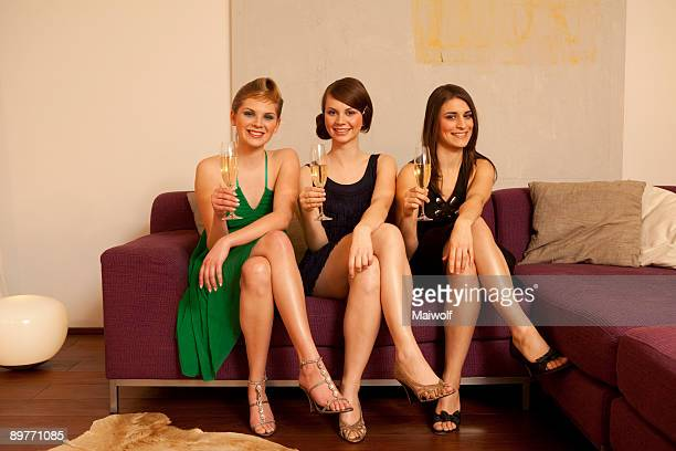 young women drinking champagne - beautiful legs in high heels stock photos and pictures
