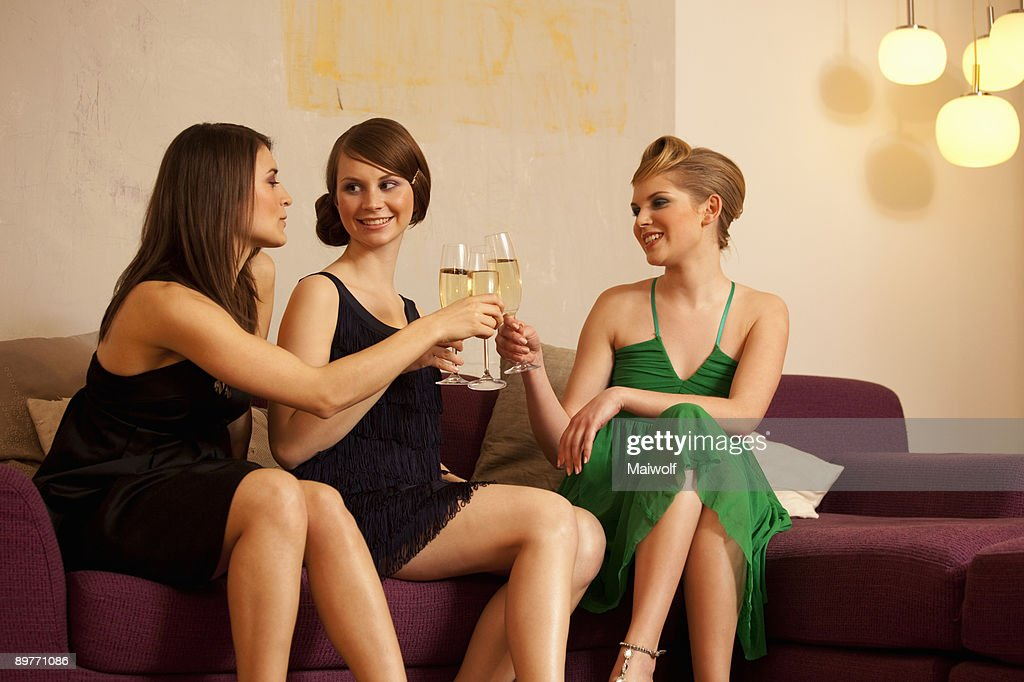 Young women drinking champagne : Stock Photo