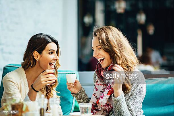 Young women drinking tea and coffee