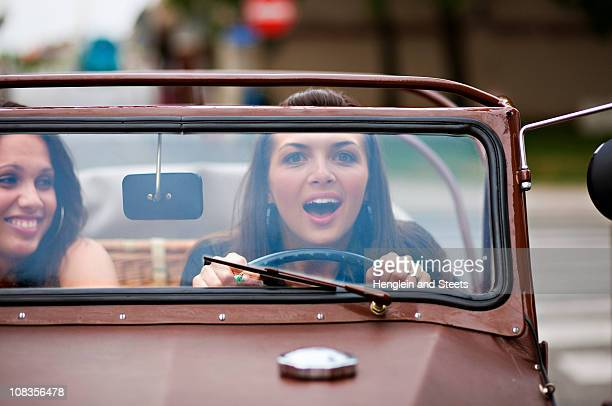 Young women driving oldtimer