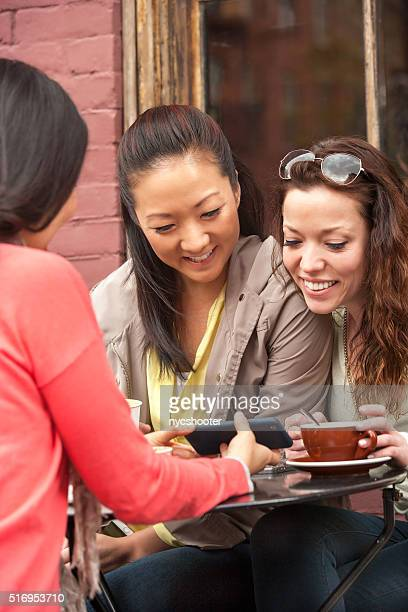 young women enjoying time together at an outdoor cafe