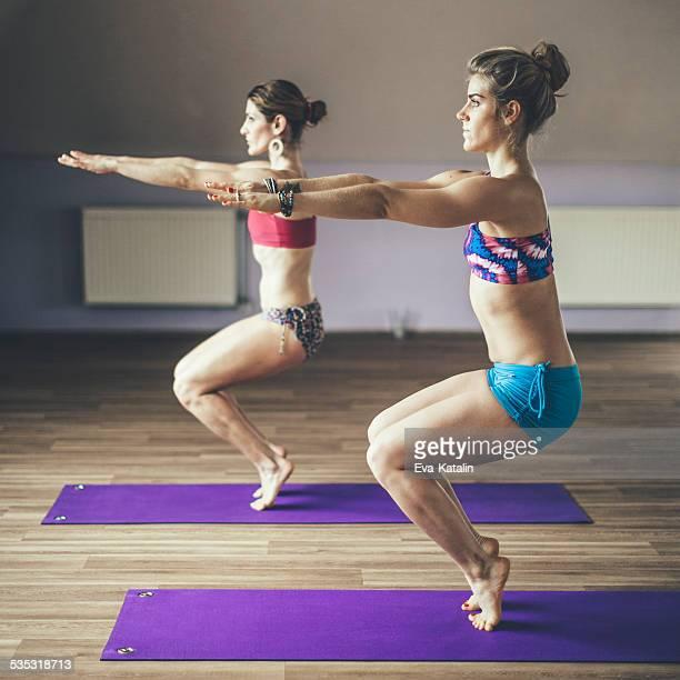 Young women exercising yoga