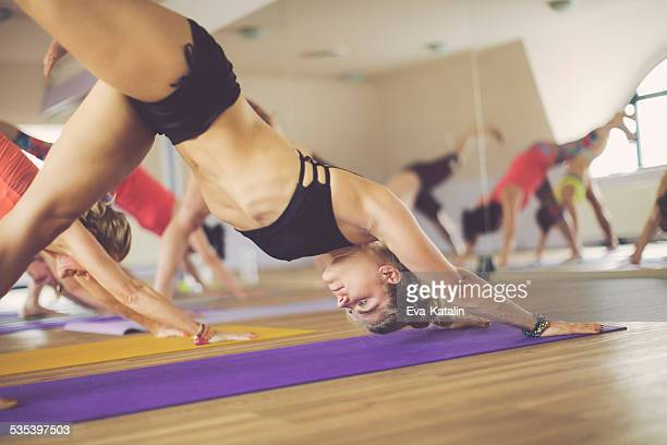 Young women exercising yoga