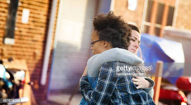 young women forgiving each other with a hug - forgiveness stock pictures, royalty-free photos & images
