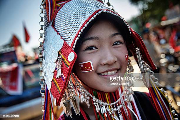 Young women from minority Akha people came to the town of Tachilek in eastern Shan state to listen to the opposition leader Aung San Suu Kyi during...
