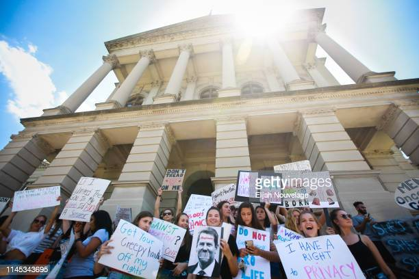 Young women from Paideia High School hold signs during a protest against recently passed abortion ban bills at the Georgia State Capitol building on...
