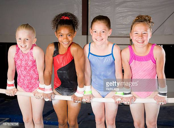 young women gymnasts in a gym - gymnastics stock pictures, royalty-free photos & images