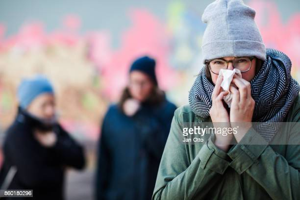 young women having a cold - pneumonia stock pictures, royalty-free photos & images